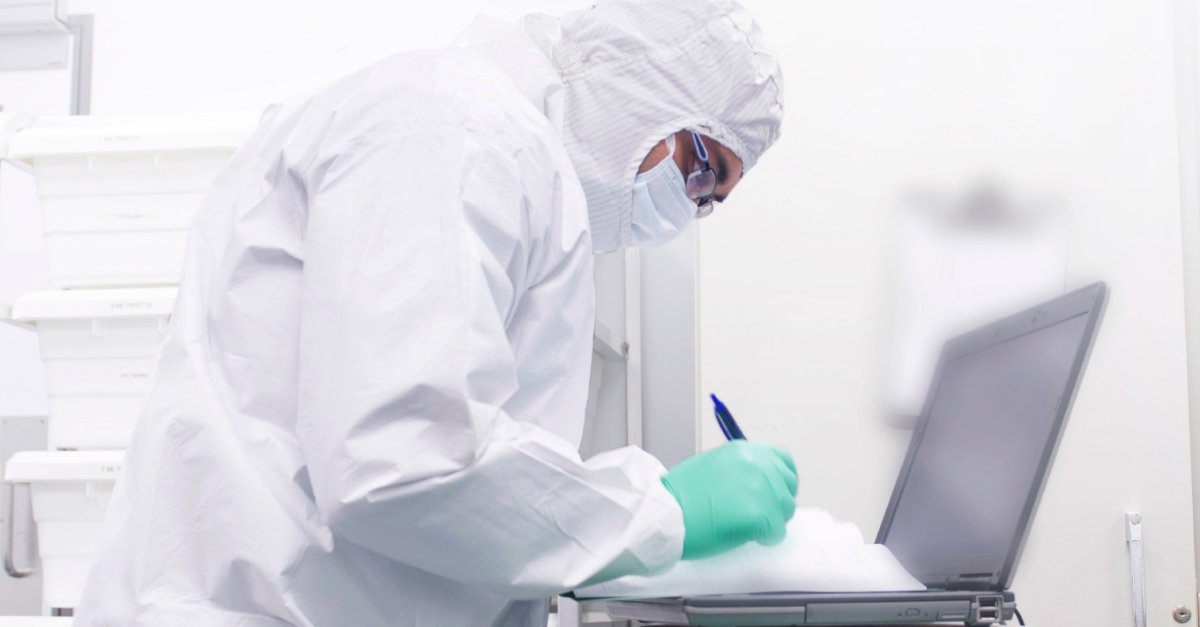 Scientist recording data for personalised medicine