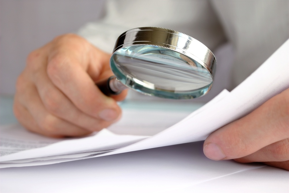 magnifying-glass-over-paper