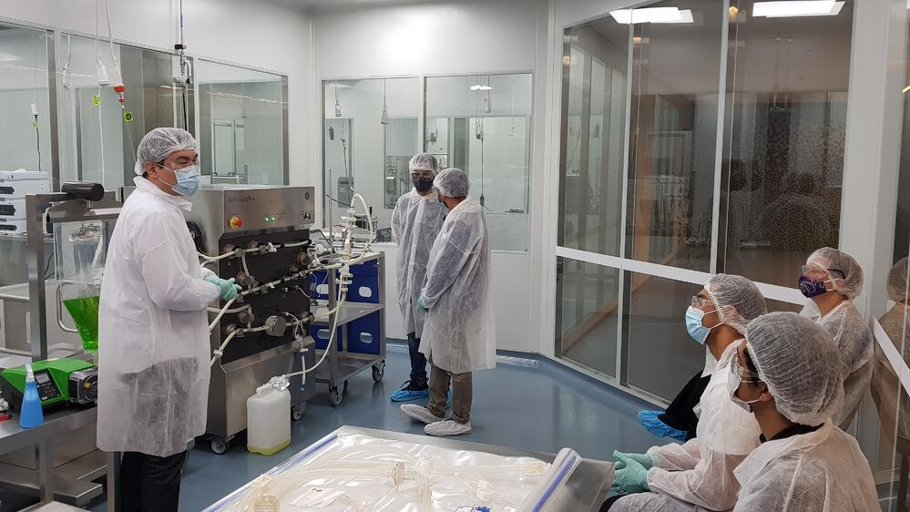 Gowned Students in Biologics Innovation Facility (BIF) as part of the Master of GMP Training at UTS